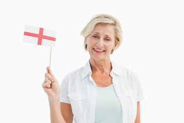 Happy mature woman holding english flag