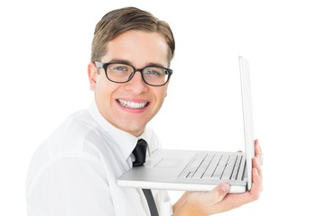 Geeky businessman holding his laptop