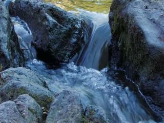 Water floating between rocks