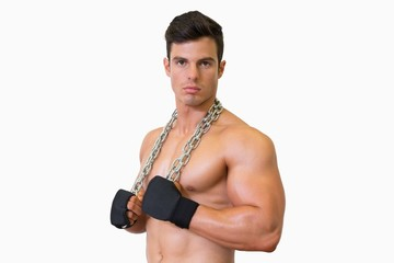 Portrait of a serious shirtless muscular man