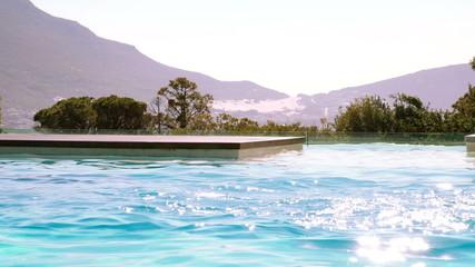 Fit swimmer doing butterfly stroke in outdoor pool