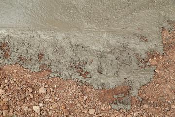 Wet cement concrete