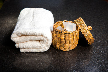 Soap in a basket and towel