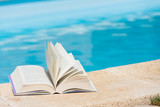 Leisure at the swimming pool with book