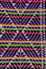Colorful african peruvian style ornament surface close up.