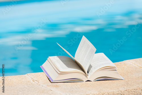 canvas print picture Leisure at the swimming pool with book