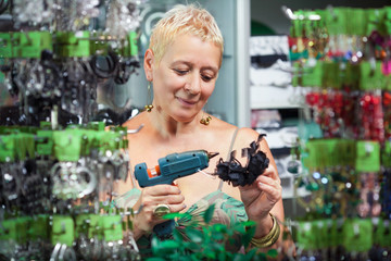 Woman is making accessories in a shop