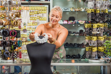 Woman arranging her accessories boutique
