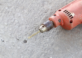 old drill with concrete