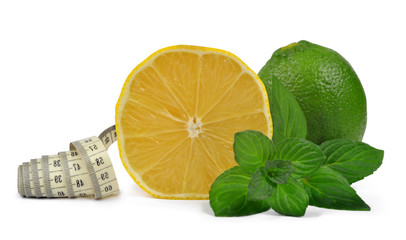 Lemons and Limes with  mint leaves and measuring tape