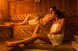 canvas print picture - Young couple in sauna