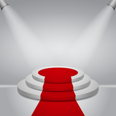 Illuminated round stage podium with red carpet