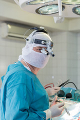 the surgeon in the operating room