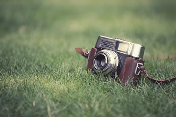 old camera on grass