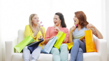smiling teenage girls with many shopping bags