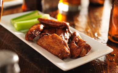 wide shot of a platter of bbq chicken wings