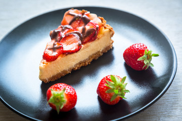 New York Cheesecake with Chocolate and Strawberries