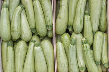 Farmers market marrows in a wooden crates, background