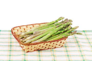 Wicker basket full with asparagus.