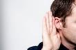 Man listening to gossip
