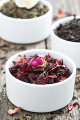 dry herbal teas in white bowls, close-up