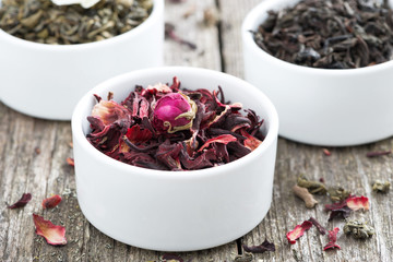 dry herbal teas in white bowls