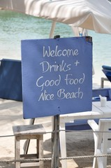 Welcome drinks, good food and nice beach sign