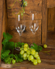 bunch of grapes and wine glasses