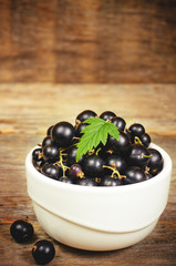 black currants in the white bowl
