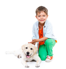 Cute little boy with his labrador