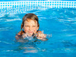 Girl swiming in a pool
