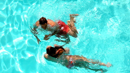 Couple having fun in the swimming pool together