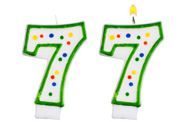 Birthday candles number seven isolated on white background