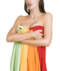 Beautiful female body wrapped in multicolored towels (color laun