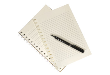 A blank white notebook and pen on the wooden table