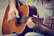 Leinwanddruck Bild - Man plays the guitar