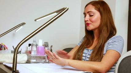 Happy customer admiring her nails