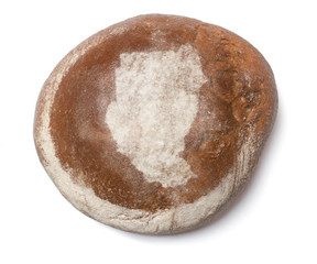 A loaf of fresh bread covered with rye flour in the shape of Sud