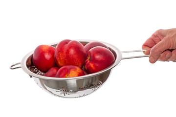 Nectarines  in a colander