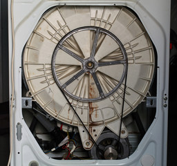 washing machine repair. spinning drum. internal mechanism