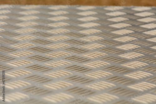 Pattern on metal seating panel
