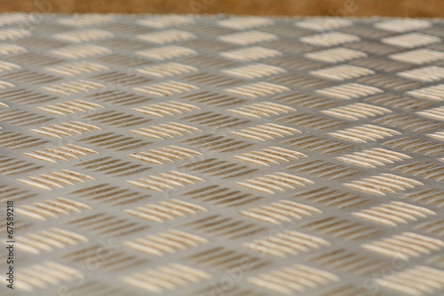 Pattern on metal seating panel