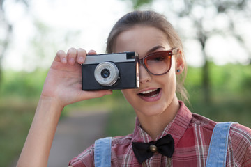 Close Up of smiling girl with retro camera