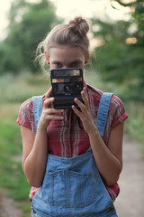 Girl photographer and instant camera