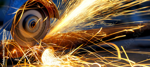 Worker cutting metal with grinder - 67590092