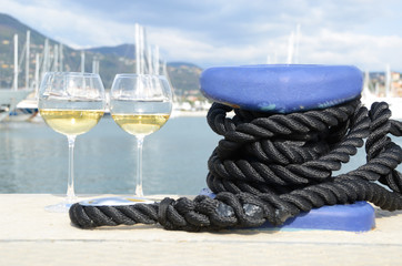 Pair of wineglasses against yachts in La Spezia, Italy