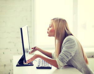 happy woman with laptop computer