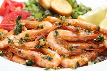 close up of fried shrimps in olive oil