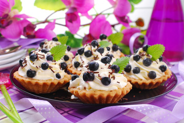 blueberry tartlets with whipped cream