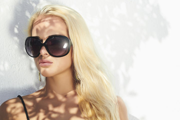 beautiful woman in sunglasses.shadows.beauty blond girl